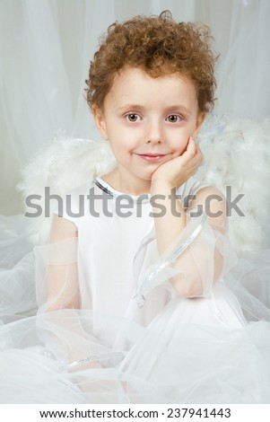 The qualitative photo made in a photographic studio. The little boy in a suit of an angel.