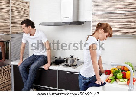 The quarrelled young married couple at kitchen