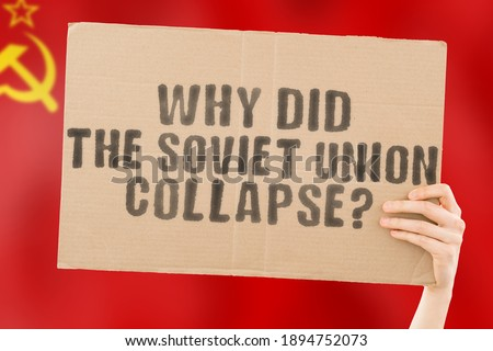 The quesiton ' Why Did the Soviet Union Collapse? ' on a banner in men's hand with blurred USSR flag on the background. Government. Power. Economy. Cold War. Communism. Crash Сток-фото ©