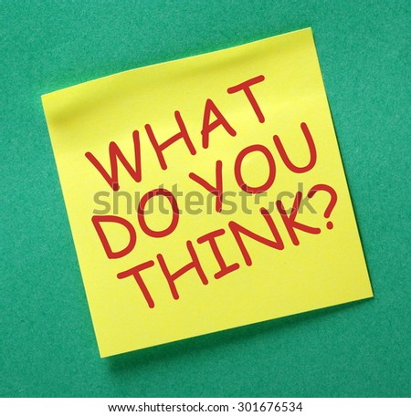 The question What Do You Think? in red text on a yellow sticky noted posted on a green notice board