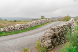 The Quiet Man Bridge is a tourist attraction in county Galway Ireland. This old stone bridge was made famous from the 1952 film starring John Wayne and Maureen O'Hara.