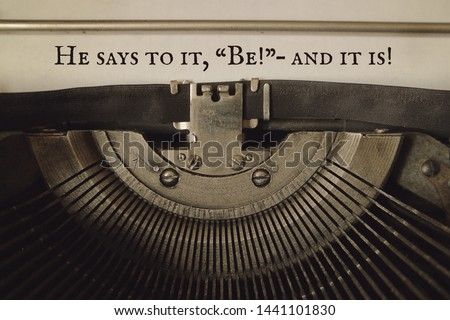 "The quotation from the Koran ""He says to it, ""Be!"" and it is!"" is typed by an old typewriter."