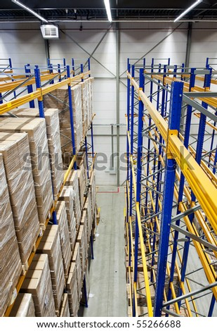 The racks and shelves of a huge warehouse seen from above