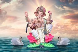 The radiant form of Ganapati on lotus flower. Ganpati festival