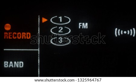 The radio on a FM and stereo mode. With the stereo mode blinking