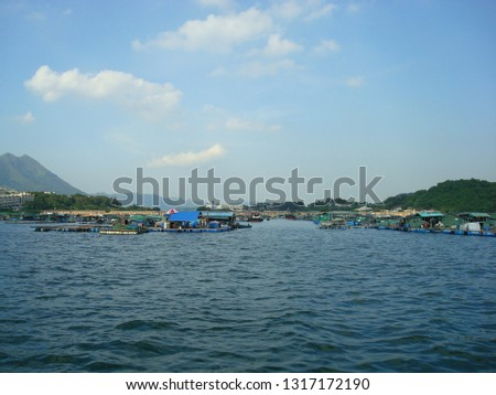 The raft floating fish farming, fish farming raft on the sea, aquaculture farming, Fish Farming Community with the background of beautiful blue sky and sea  #1317172190