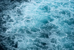The raging waters of the raging ocean. A cap of sea foam in a whirlpool.Abstract. Background.