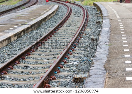 The railroad tracks curve along the way For train travel Bangkok Thailand. #1206050974