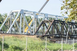 The railway bridge is made of steel.