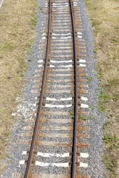 the railway goes on the ground and is built of high-quality metal alloy rails, sleepers make for strengthening the roadbed, for the movement of locomotives and other railway transport
