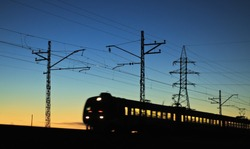 The railway line at night, the train of motion, electric line.
