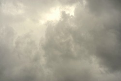 The rain clouds began to gather in the sky in the afternoon.