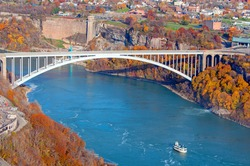 The Rainbow Bridge spanning the Niagara River and the international border between Niagara Falls, Ontario, Canada and Niagara Falls, New York, United States.