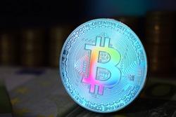 The rainbow physical bitcoin coin is BTC, preferably color blue.