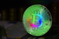 The rainbow physical bitcoin coin is BTC, preferably color green.