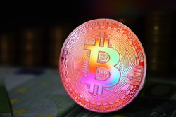 The rainbow physical bitcoin coin is BTC, preferably red and yellow color.