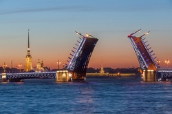 The raised Palace bridge at white nights in the city of St.-Petersburg