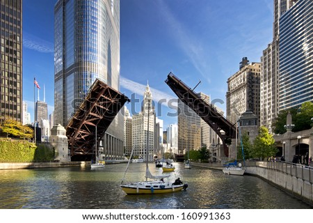 The raising of the bridges on the Chicago River signals the end of another sailing season as sailboats move from their harbor on Lake Michigan to their winter dry dock location.
