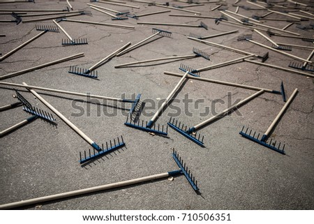 The rake spread out on the sidewalk #710506351