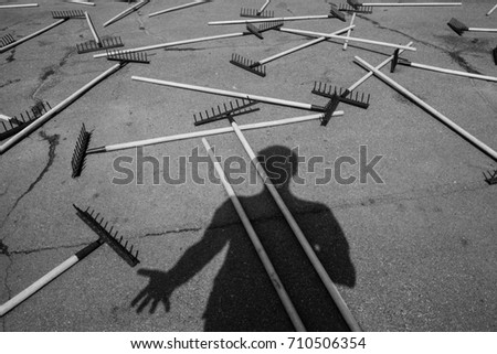 The rake spread out on the sidewalk #710506354