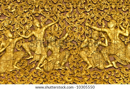 The ramayana epic carved on a wood door inside a temple. Luang Prabang, Laos.