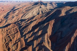 The Raplee Anticline and San Juan River in aerial over Utah desert