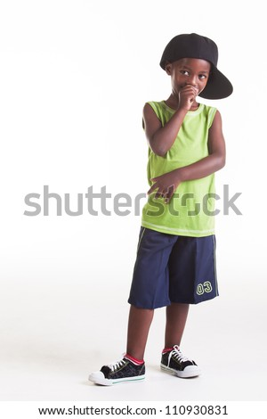 The rapper child in the studio with his rap clothes.