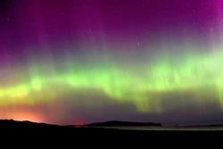 The rare sight of colourful Aurora Australis display seen from Oreti Beach, Invercargill.