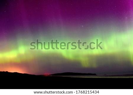 The rare sight of colourful Aurora Australis display seen from Oreti Beach, Invercargill. Stockfoto ©