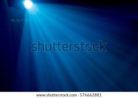 The rays of searchlights in smoke on stage during a performance #576662881