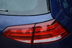 The rear light of a Volkswagen Golf motor car, England, UK - 2020