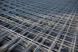 The rebar is bonded with steel wire for use as a construction infrastructure. Which part of the rebar has rusted due to chemical reactions