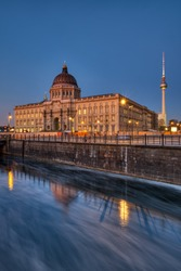 The reconstructed Berlin Palace with the Television Tower at night