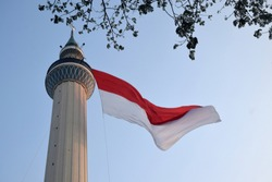 The red and white Indonesian giant flag was hoisted on the tower of the Great Mosque of Surabaya, East Java, Indonesia. Welcoming Indonesia's 74th independence day