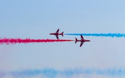 The Red Arrows Jet plane flying in blue sky wiht Colorful smoke.Aerospace exhibition at airshow in Zhuhai, Guangdong Province of China.