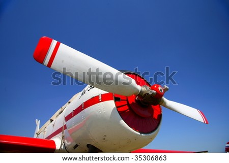 The red beautiful propeller of background blue sky