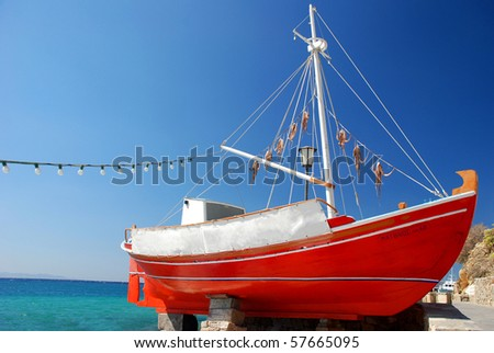 The red boat with octopus on the island of Mykonos, greek colours
