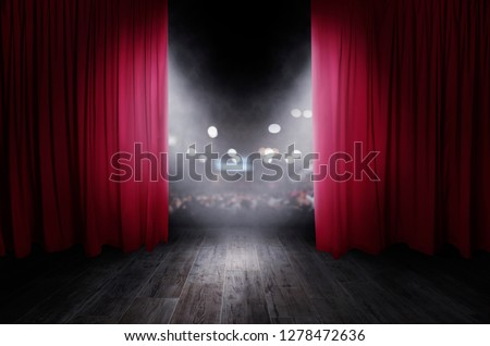 The red curtains are opening for the theater show #1278472636