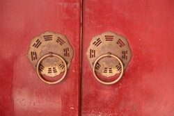The red gate of the temple with Golden door knocker