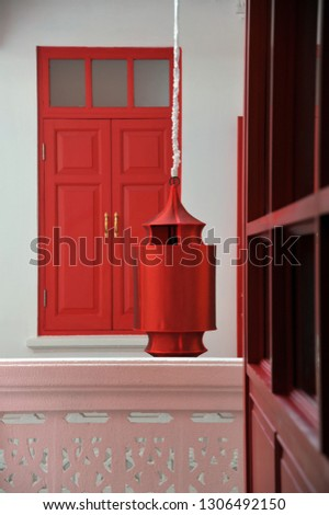 The red lantern and the red door in a Chinese house
