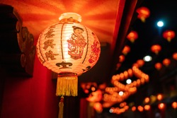 The red lantern has two pictures of children turning on the lights that adorn the Chinese New Year festival. Words Chinese language mean