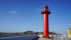 The red lighthouse. jeongok port. jeongok harbor of korea.