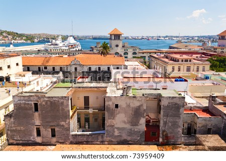 The red roofs of Old Havana with a cruiser ship in the nearby bay