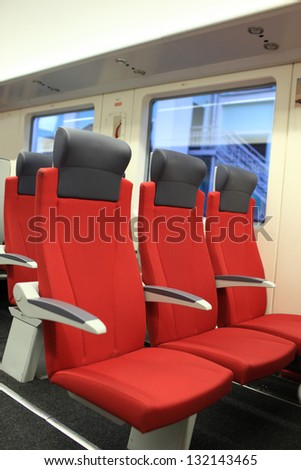 The red seats are in a train
