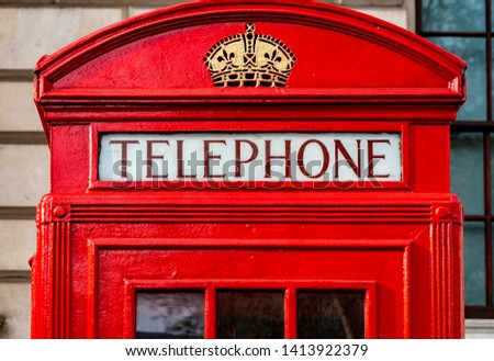 The red telephone box, a telephone kiosk for a public telephone. #1413922379