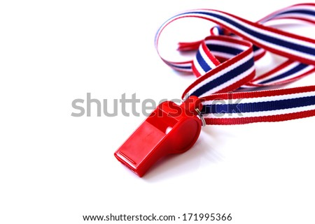 The red whistle isolated on the white background