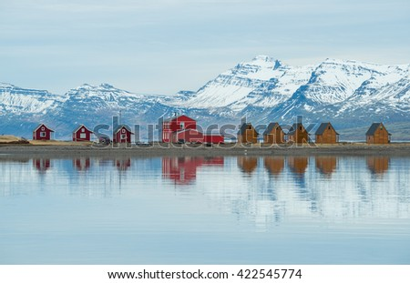 The reflection of the small cottage in east Iceland.