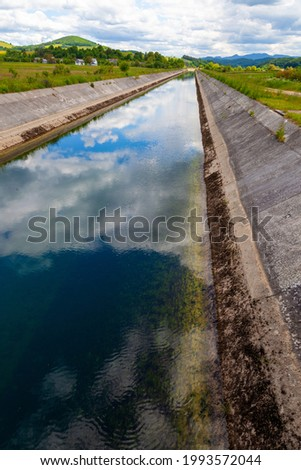 The regulated and artificial riverbed of the Gacka River in Lika region, Croatia