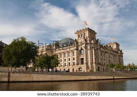 The Reichstag is the seat of the German federal parliament The Bundestag. It is located in Berlin, Germany. The Spree River is seen in the foreground.