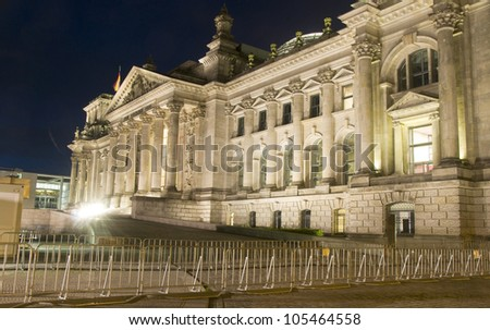 The Reichstag Parliament building main entrance flags blowing night light Berlin Germany Europe